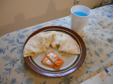 Homemade quesadilla and KoolAid with not-so-homemade Taco Bell sauce