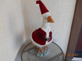 A duck dressed like Santa