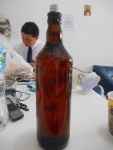 Elder Sorenson with a bottle of honey we got from our investigator